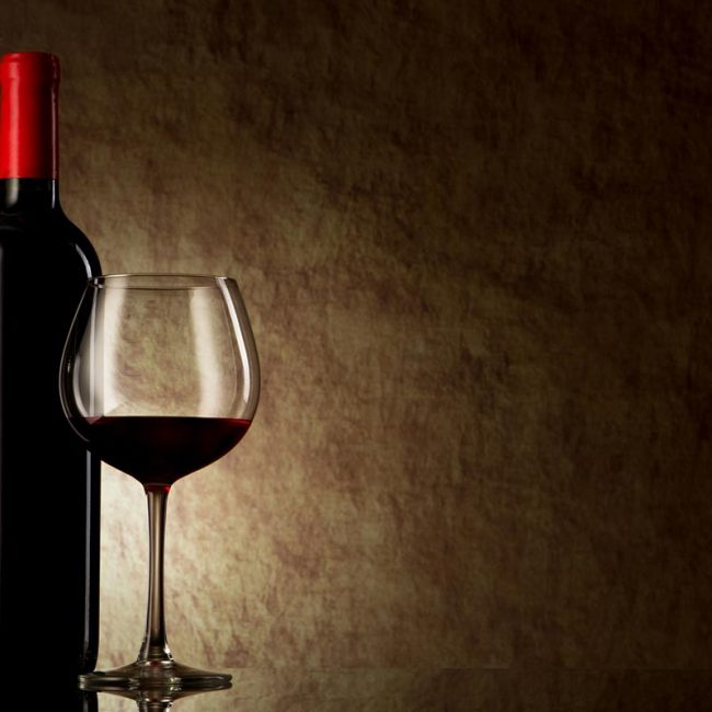 photodune-1930437-bottle-with-red-wine-and-glass-on-a-old-stone-m